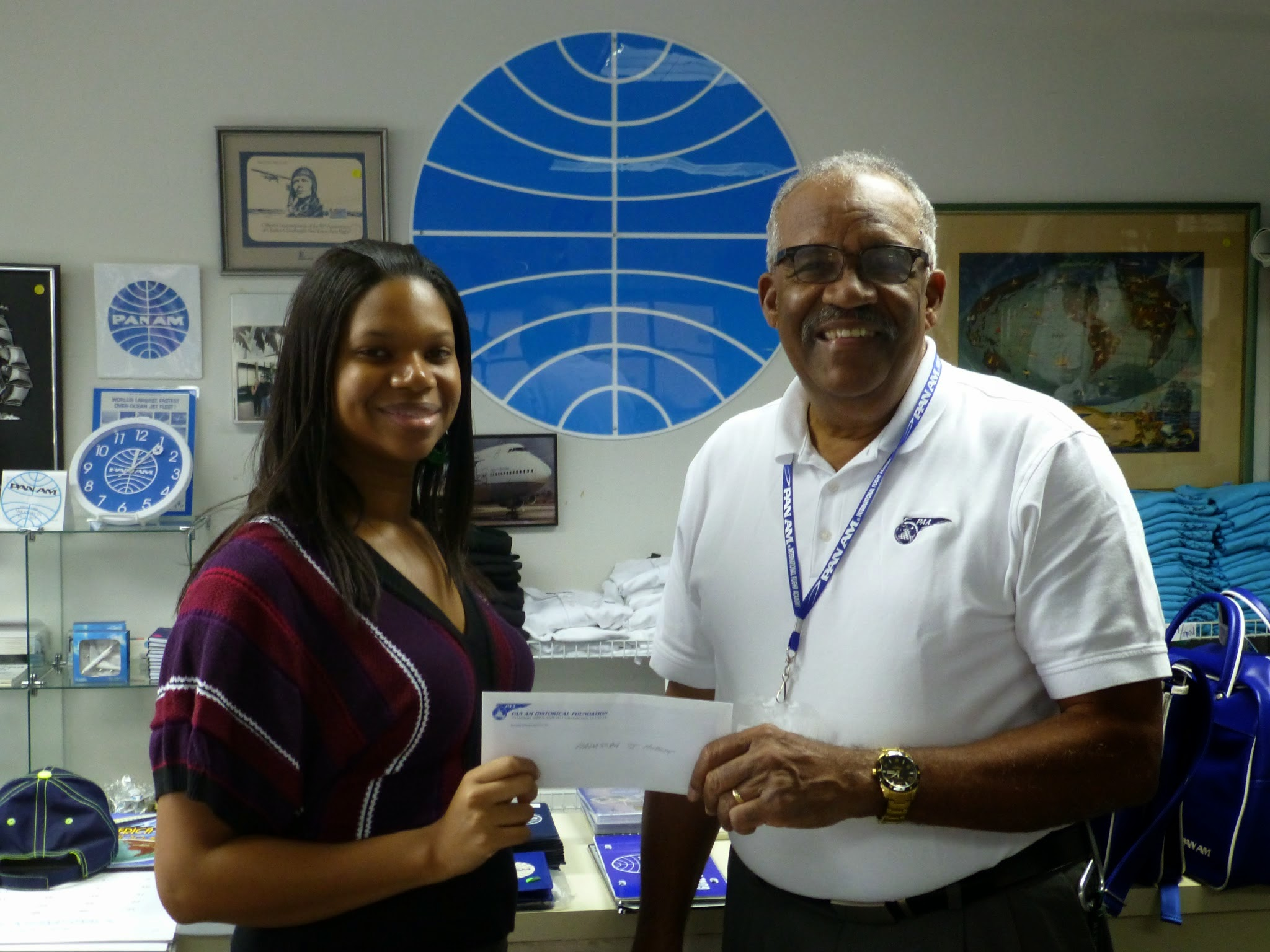 Grant winner Hadassah St. Hubert receives her award from former Pan Am pilot Al Topping